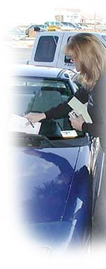 Code enforcement officer writing a ticket
